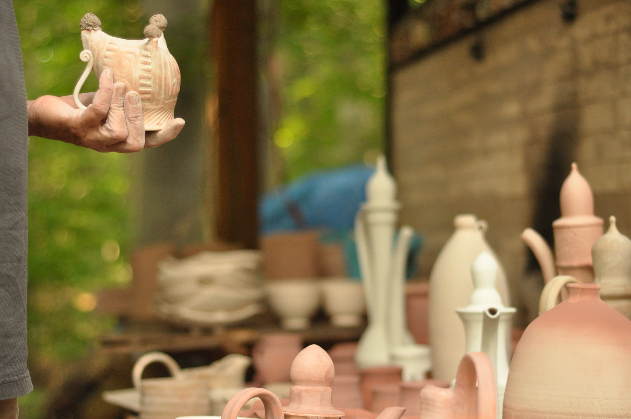 Do you want a bishop?: Ceramic artist Dennis Maust with his pieces.