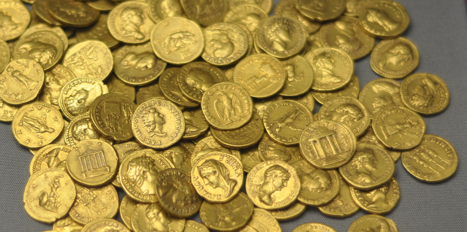 Gold aureus coins with the faces of various Roman Leaders. These coins were found below the floor of a Roman house in Corbridge in 1911. From the British museum.